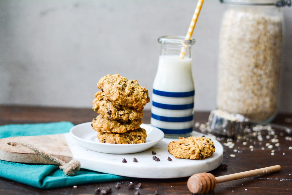 chocolate chip cookies stacked with milk