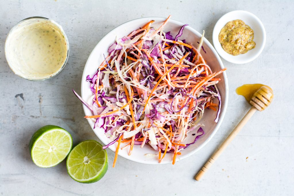 image of coleslaw with limes